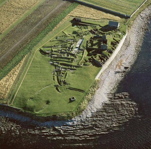 An aerial photograph showing extensive multi period archaeological remains on a coastal site