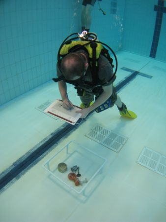 Figure 36: The Nautical Archaeology Society with the assistance of Historic Scotland have made great strides since 2010 with the re-introduction of training opportunities throughout Scotland; ranging from introductory courses to field schools run through regional training centres. The training allows for real hands on involvement such as pool sessions to practice newly acquired 2D survey skills ©NAS.