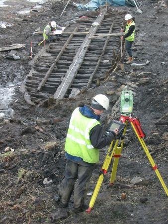 Figure 24: Excavation of the Leamington Scow on the Union canal in Edinburgh. An indication of how rare and unexpected discoveries through developer-funded work can contribute to cross-sector research opportunities and the capability in dealing with important archaeological discoveries within commercial constraints, ©Headland Archaeology.