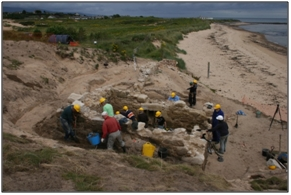 Figure 38: Local volunteers working on the community excavation at the eroding salt pans at Brora, Sutherland. This masonry, buried for hundreds of years in the dune, is the oldest that survives in the village, ©SCAPE