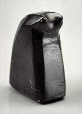 Figure 52: Jet chess bishop of abstract form from a 14th century context in Perth (Meal Vennel), probably the possession of a burgess. Being made of jet would also have given the piece an amuletic quality, © Perth Museum and Art Gallery, Perth ans Kinross Council, Scotland.