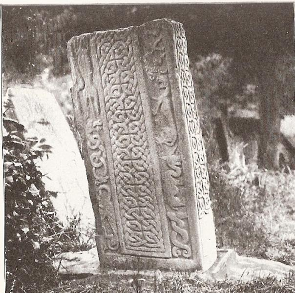 Sepia image of a rectangular pictish carved stone with animals and interlace decoration