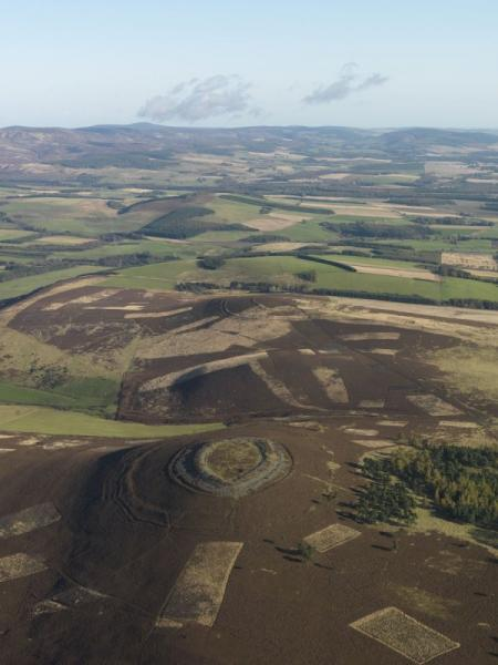 An oblique aerial photograph showing the substantial defensive remains of two hillforts in an upland location