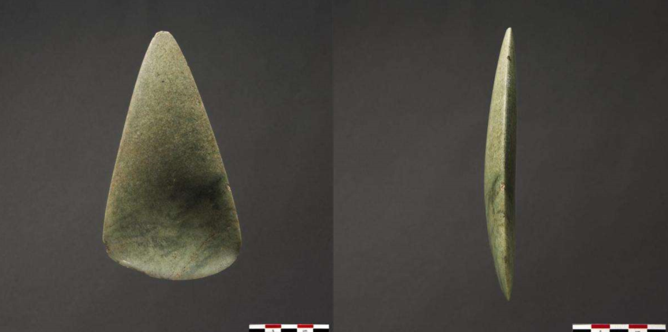 Photographs showing the side and profile of a polished axehead greenish in colour