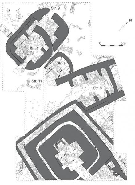A ground plan showing large rectangular structures with internal partitions and stone features